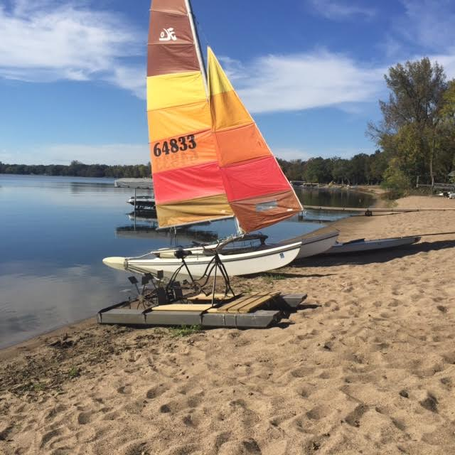 Catamaran on sandy lake beach